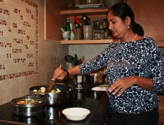 Stirring Alu and Gobi with spices