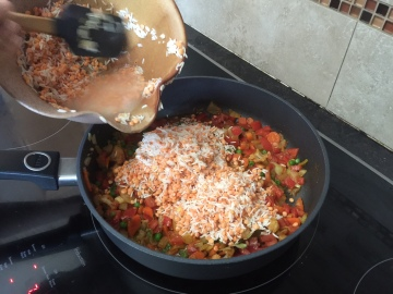 Add the soaked rice and daal